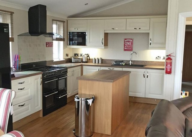 The fully fitted kitchen offers all mod-cons including a range cooker, wine cooler and even a coffee machine